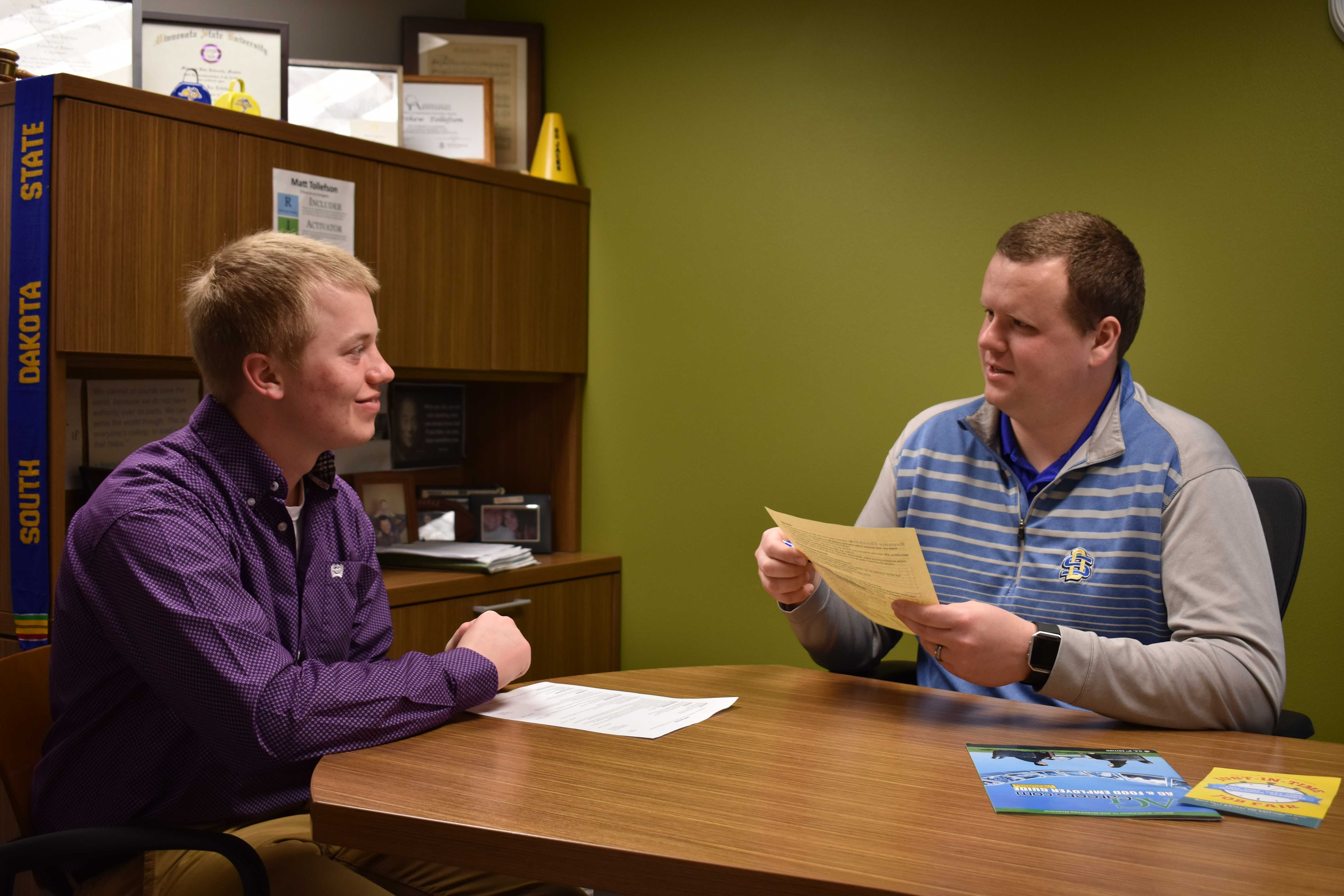 FILE PHOTO Sam Johnson, agricultural business major, and Matt Tollefson, career coach, in a mock interview.