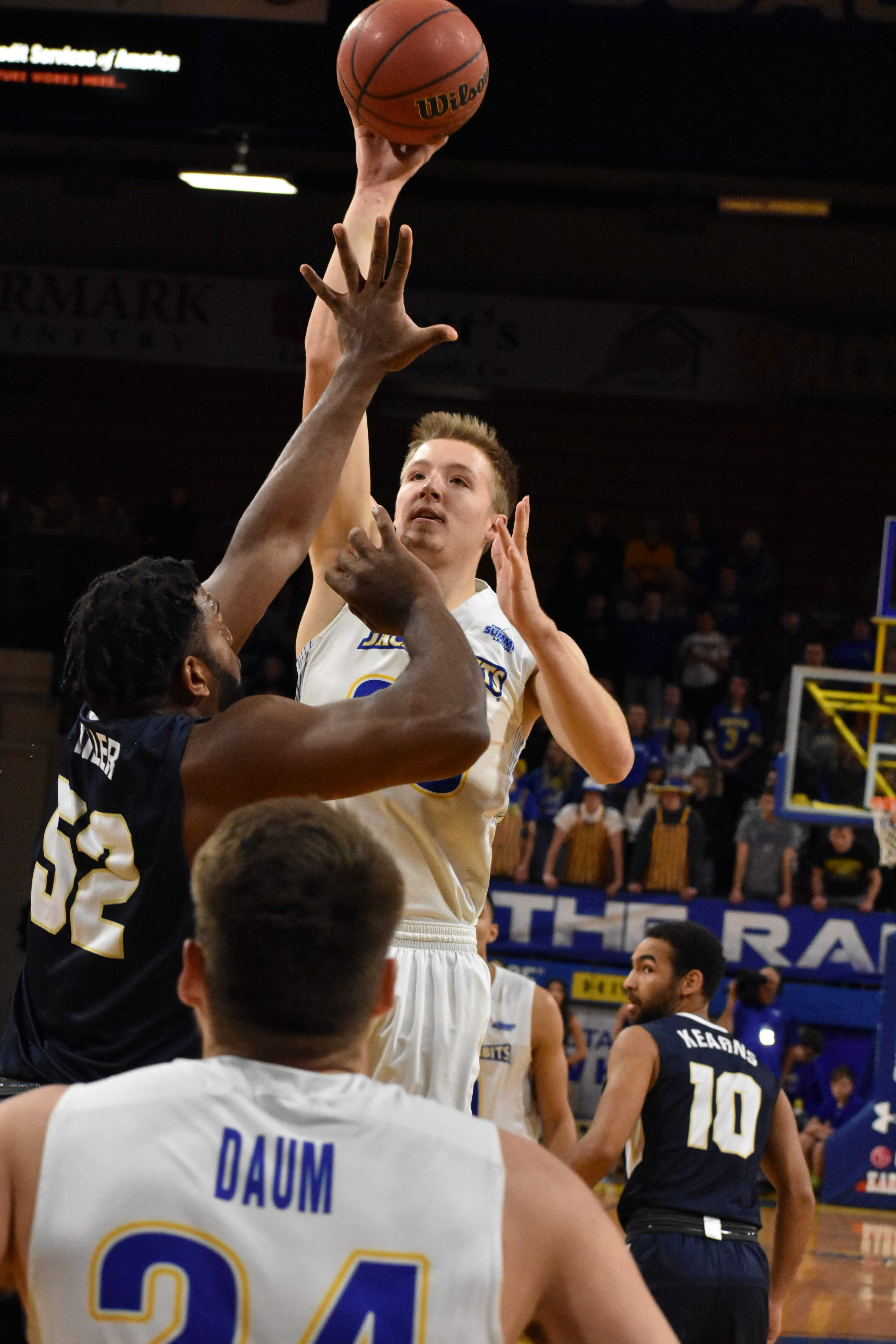 Senior forward guard Reed Tellinghuisen (23) takes a jump shot over Oral Roberts forward Chris Miller (52) during the first half of the game Thursday, Jan. 11. The Jacks beat the Golden Eagles 78-73.