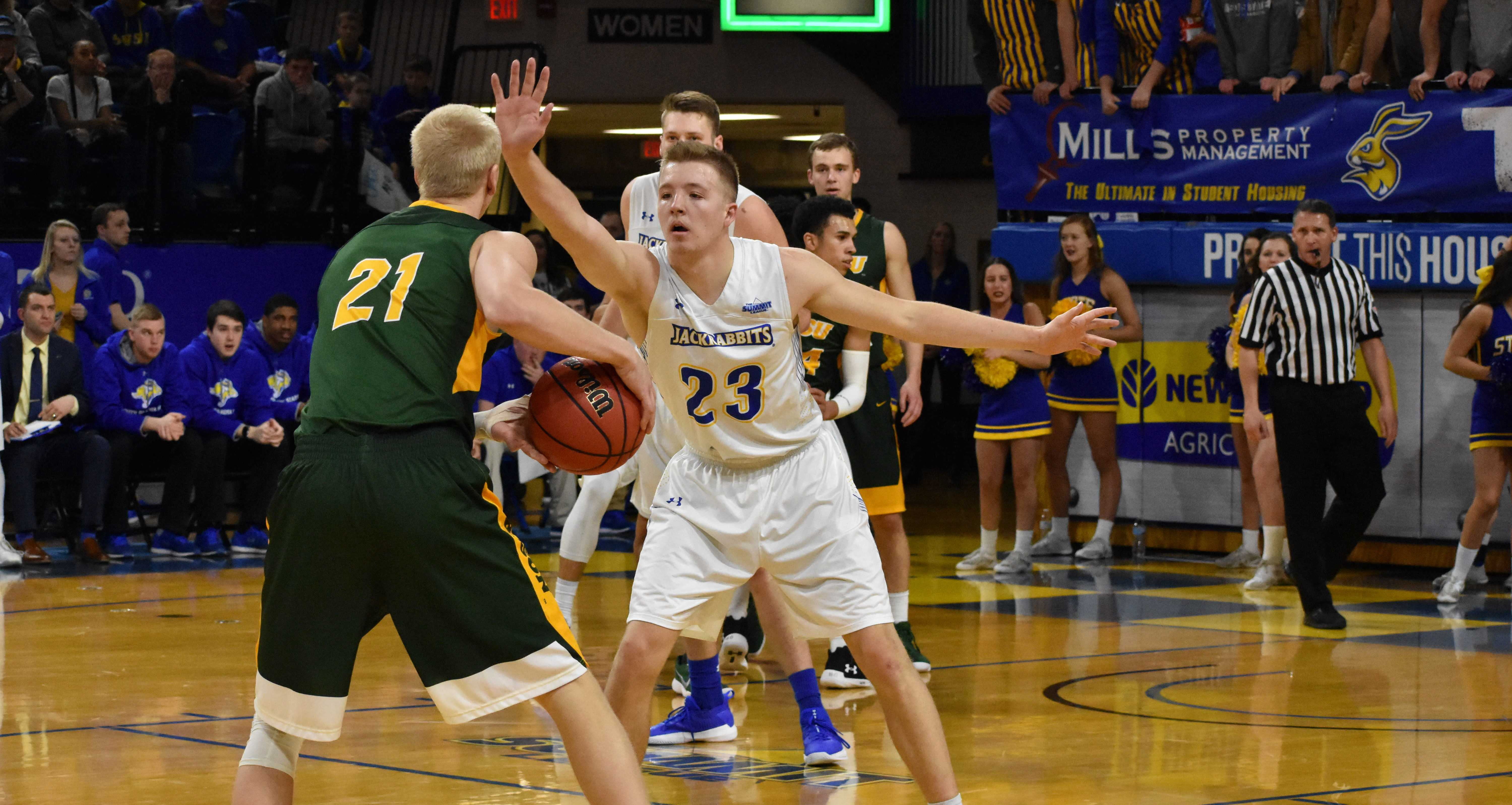 ABBY FULLENKAMP Senior forward guard Reed Tellinghuisen (23) blocks NDSU forward guard A.J. Jacobson (21) during the first half of the game Feb. 1. The Jacks beat the Bison 82-63. They host Western Illinois at 2pm Saturday, Feb. 17 in Frost Arena.