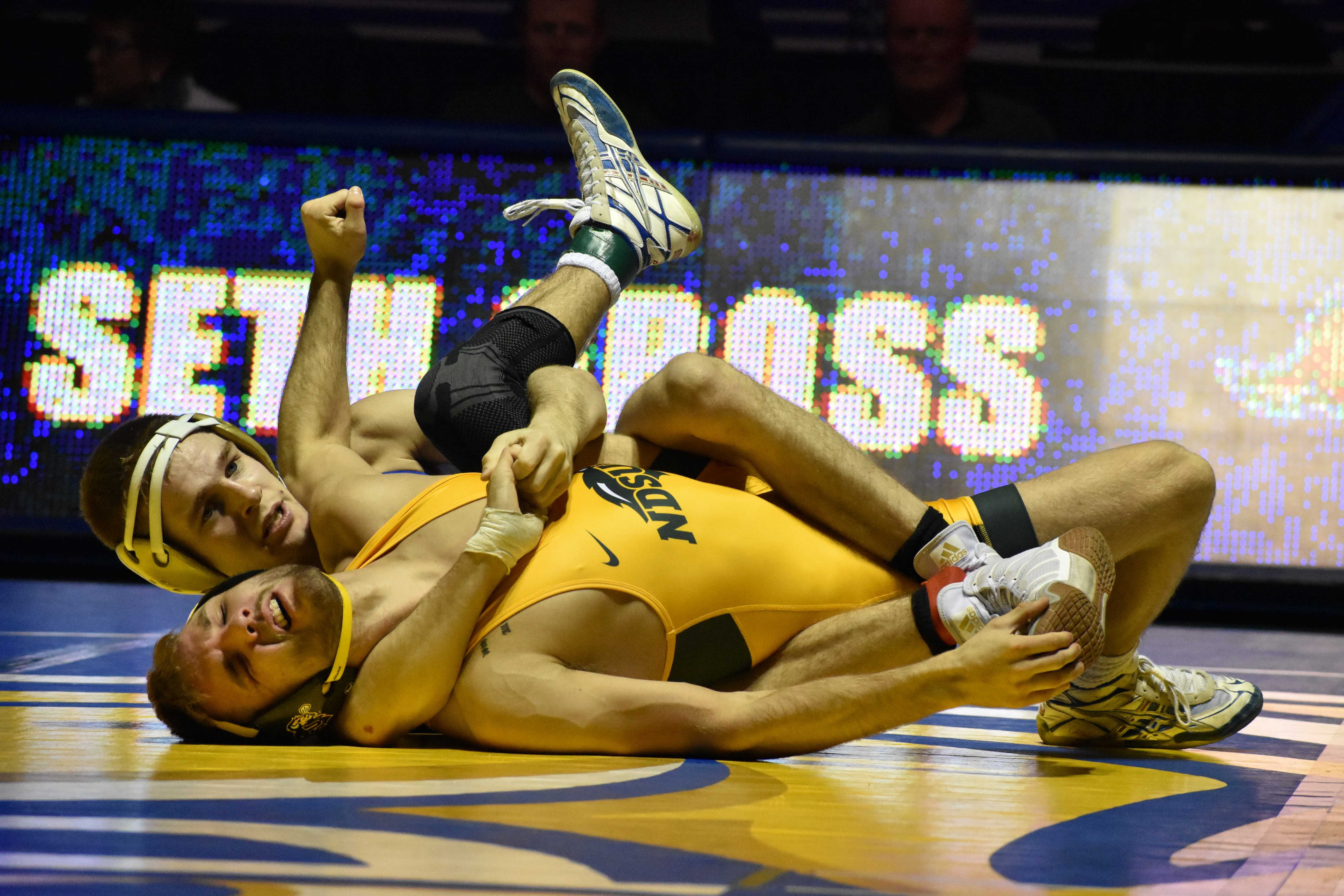 ABBY FULLENKAMP Junior Seth Gross wrestles against NDSU Cam Sykora during the 133-pound bout Feb. 16. Gross defeated Sykora by tech fall of 16-0 in four minutes. The Jacks are undefeated in the Big 12 Conference. SDSU is participating in the Big 12 Championships this weekend in Tulsa, Oklahoma. The Jacks finished the season 8-0 against Big 12 opponents.