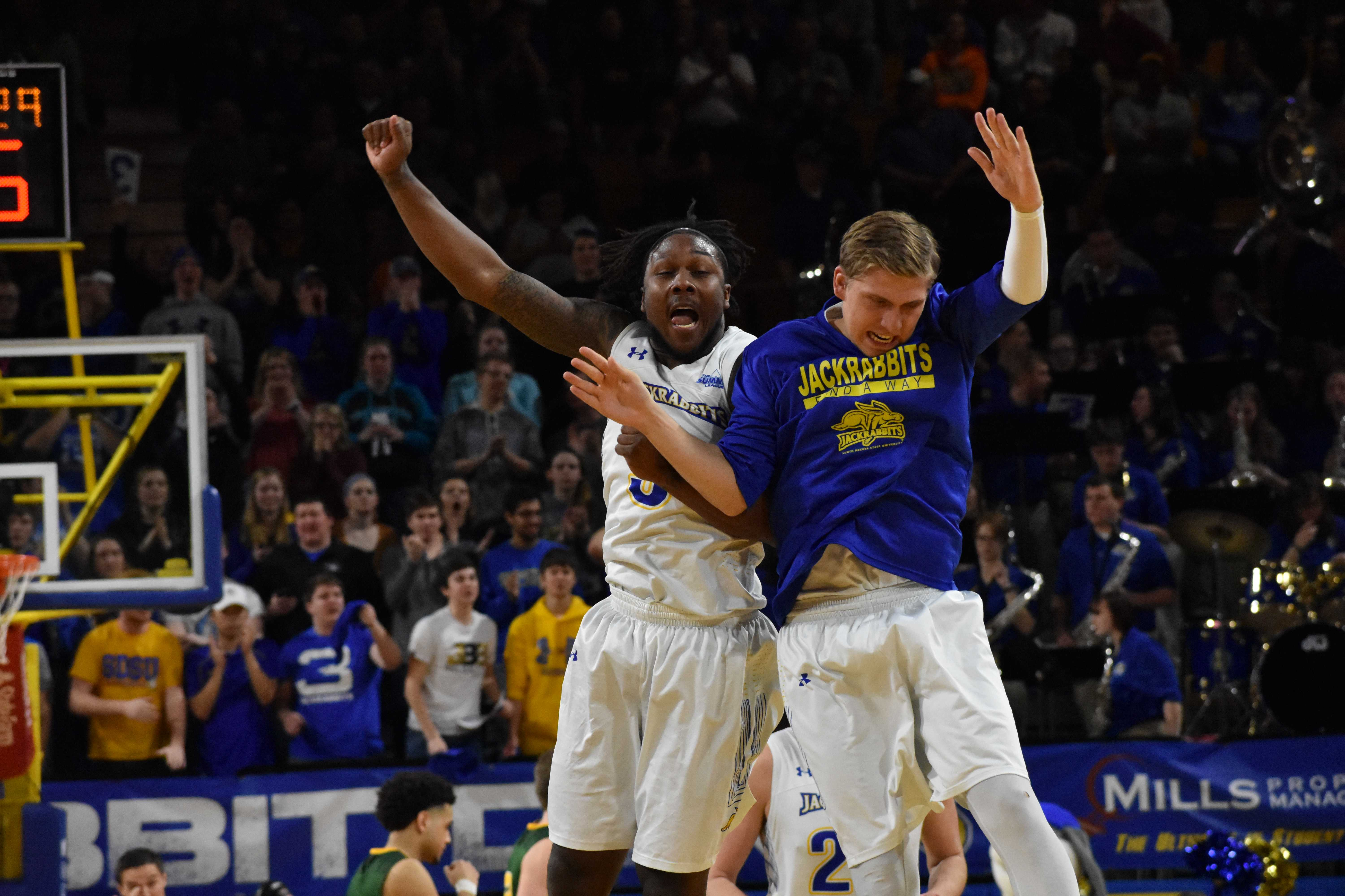 ABBY FULLENKAMP Freshman guard David Jenkins Jr. (5) and sophomore guard Beau Brown (15) celebrate Jenkins' layup before a media timeout during the second half of the game against NDSU Feb. 1. The Jacks beat the Bison 82-63. They host Western Illinois at 2pm Saturday, Feb. 17 in Frost Arena.
