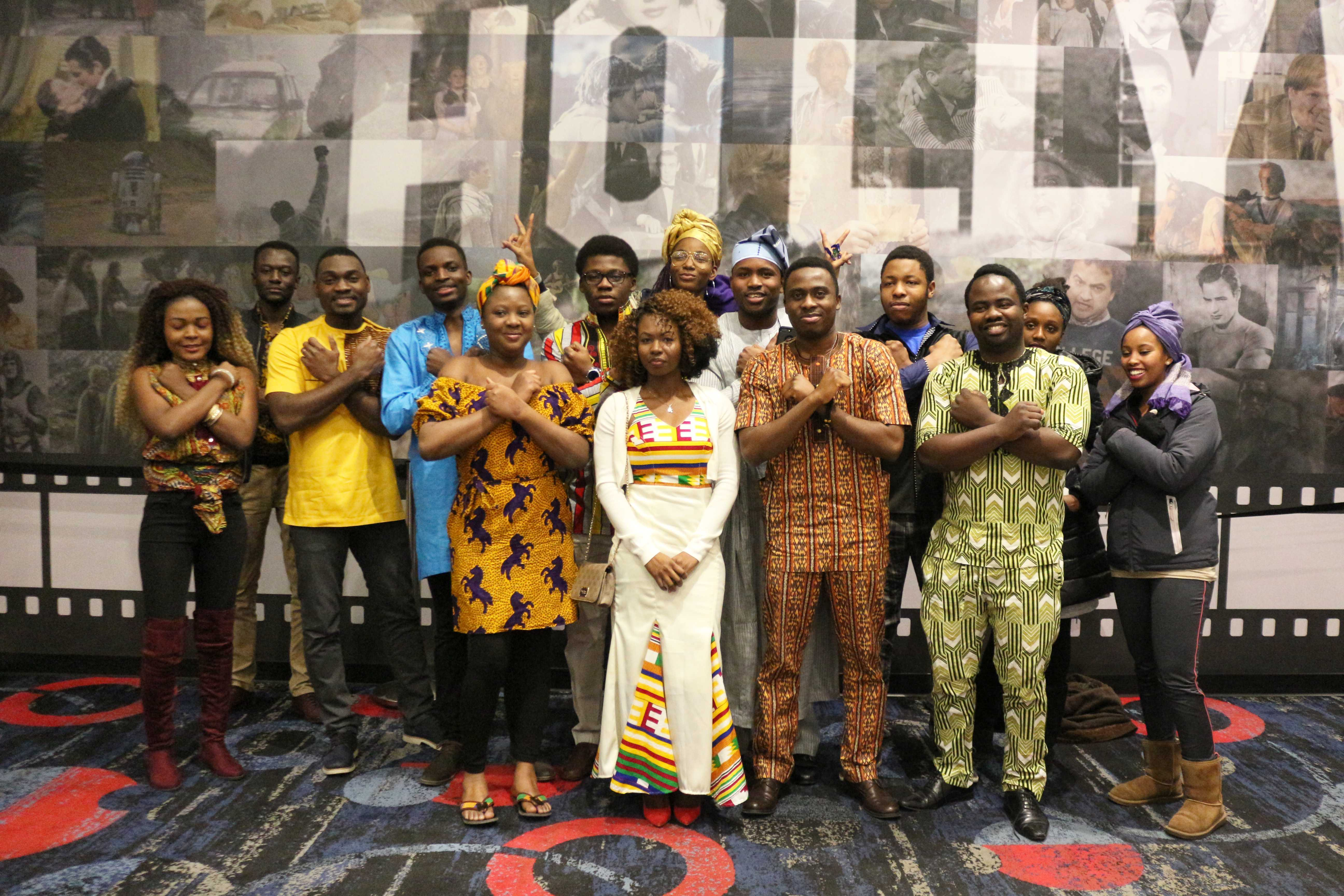 """IAN LACK Members of the ASA pose for photos after the showing of """"Black Panther."""" Many were dressed in traditional African clothing from their respective native countries."""