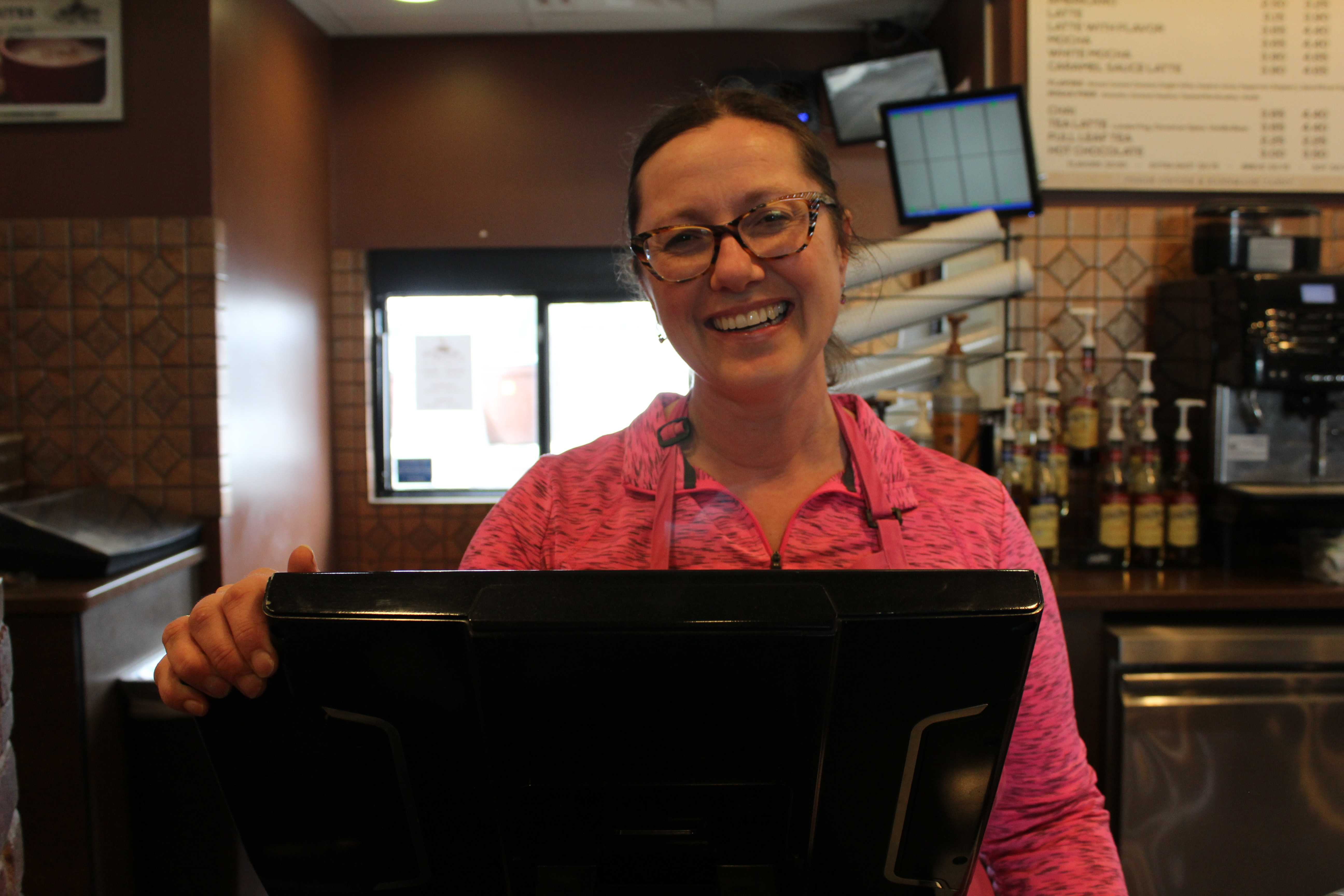 MIRANDA SAMPSON Donna Behrend, owner of Choco Latte, serves customers March 20. Choco Latte is located on the south side of Sixth Street next to Game Stop and Qdoba.