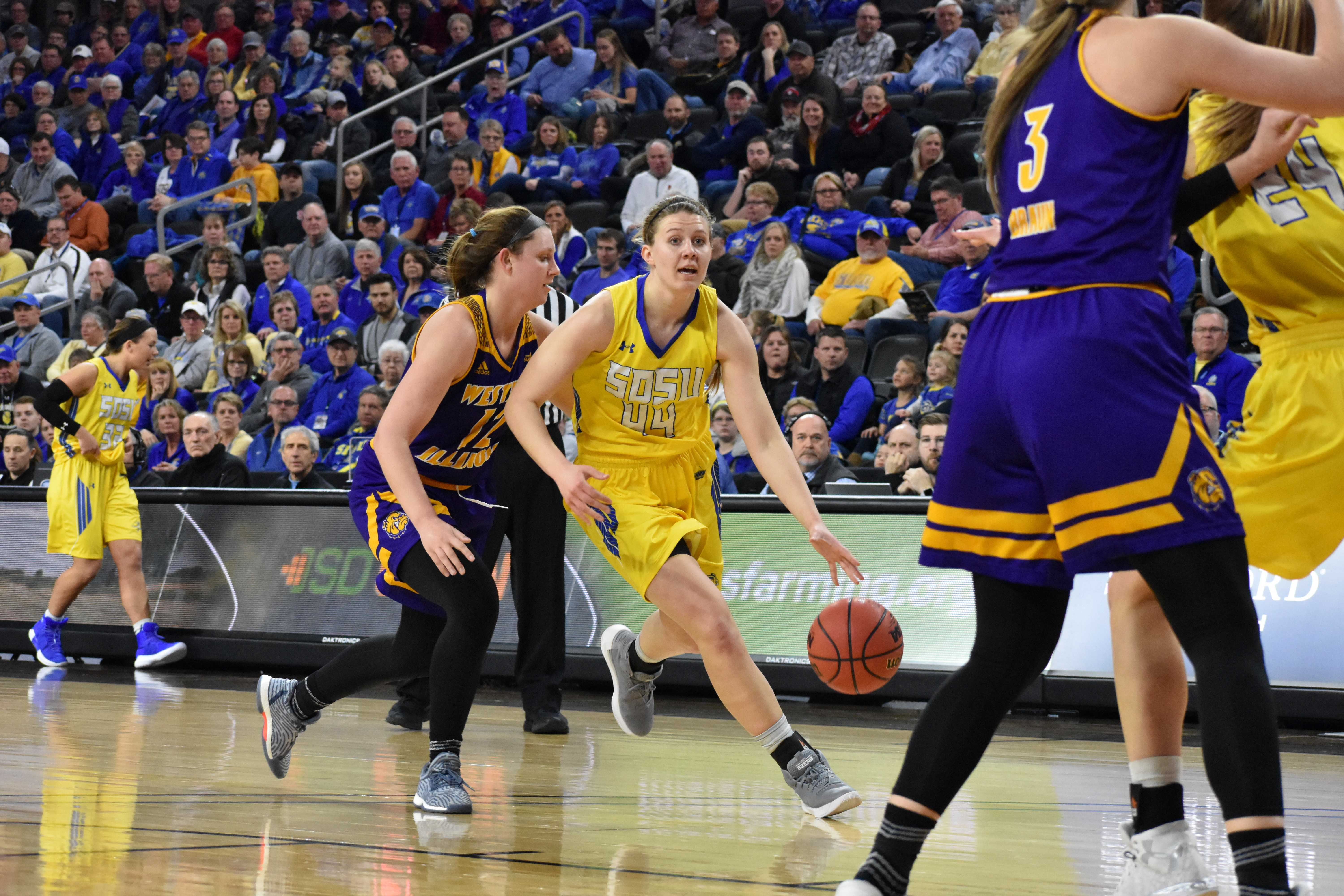 ABBY FULLENKAMP Freshman F/G Myah Selland (44) drives the ball down the court during the first half of the game against WIU March 5. The Jacks won 80-51.