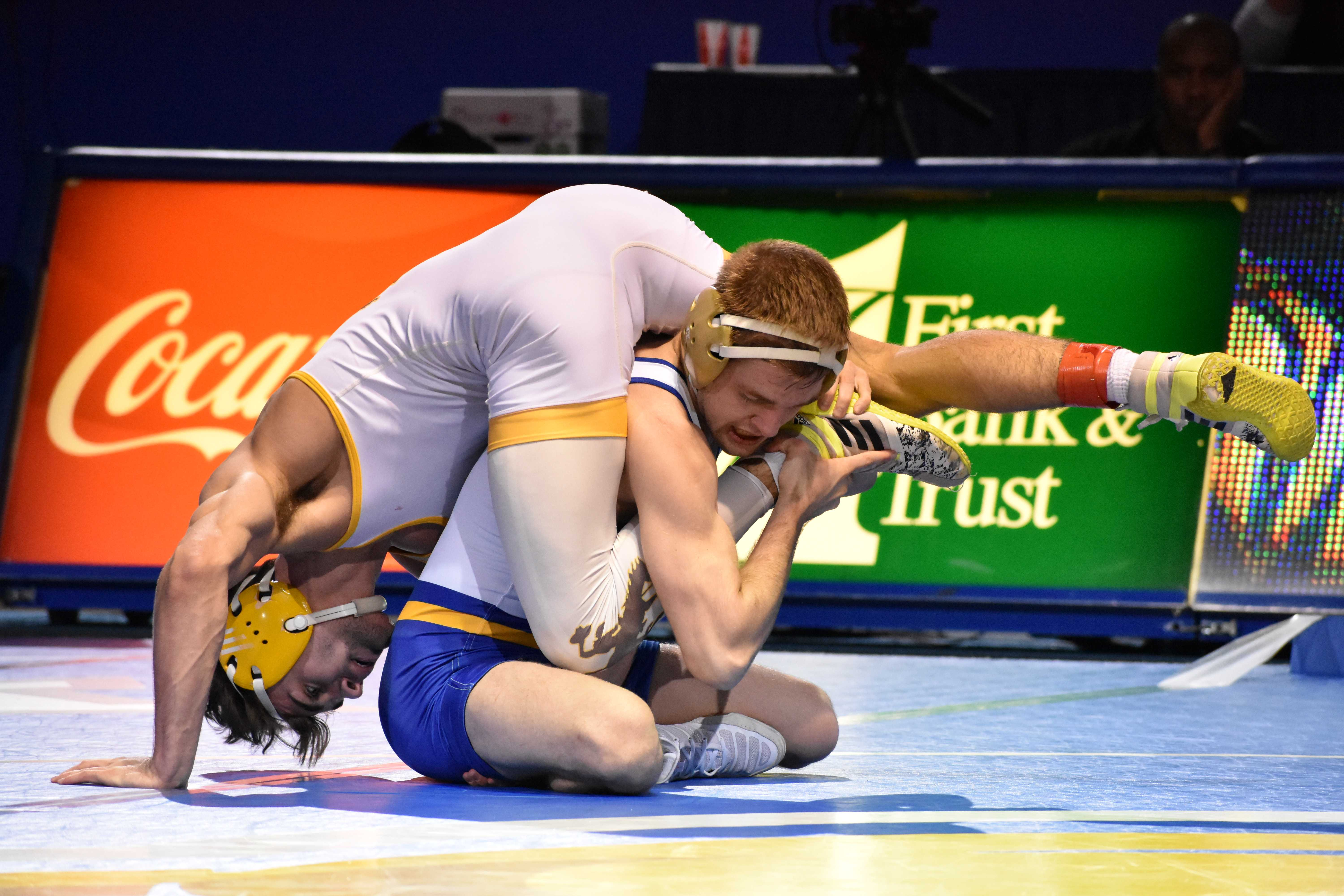 FILE PHOTO Junior Seth Gross wrestles against Wyoming's Bryce Meredith during the 141-pound bout Jan. 18. Meredith defeated Gross with a decision of 4-2. Gross won the 133-pound title at the NCAA Devision I Championships March 17 in Cleveland, Ohio.