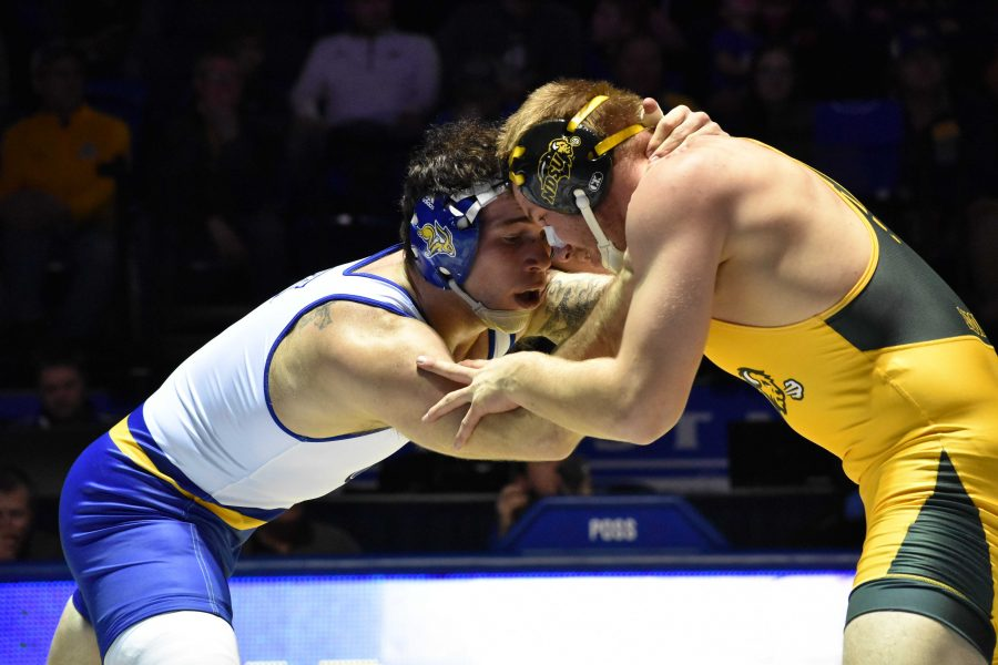 ABBY+FULLENKAMP%0ASenior+Nate+Rotert+wrestles+against+NDSU+Cordell+Eaton+during+the+197-pound+bout+Feb.+16.+Rotert+defeated+Eaton+with+a+decision+of+3-1.+SDSU+is+sending+seven+wrestlers+to+the+NCAA+Championships+in+Cleveland%2C+Ohio.