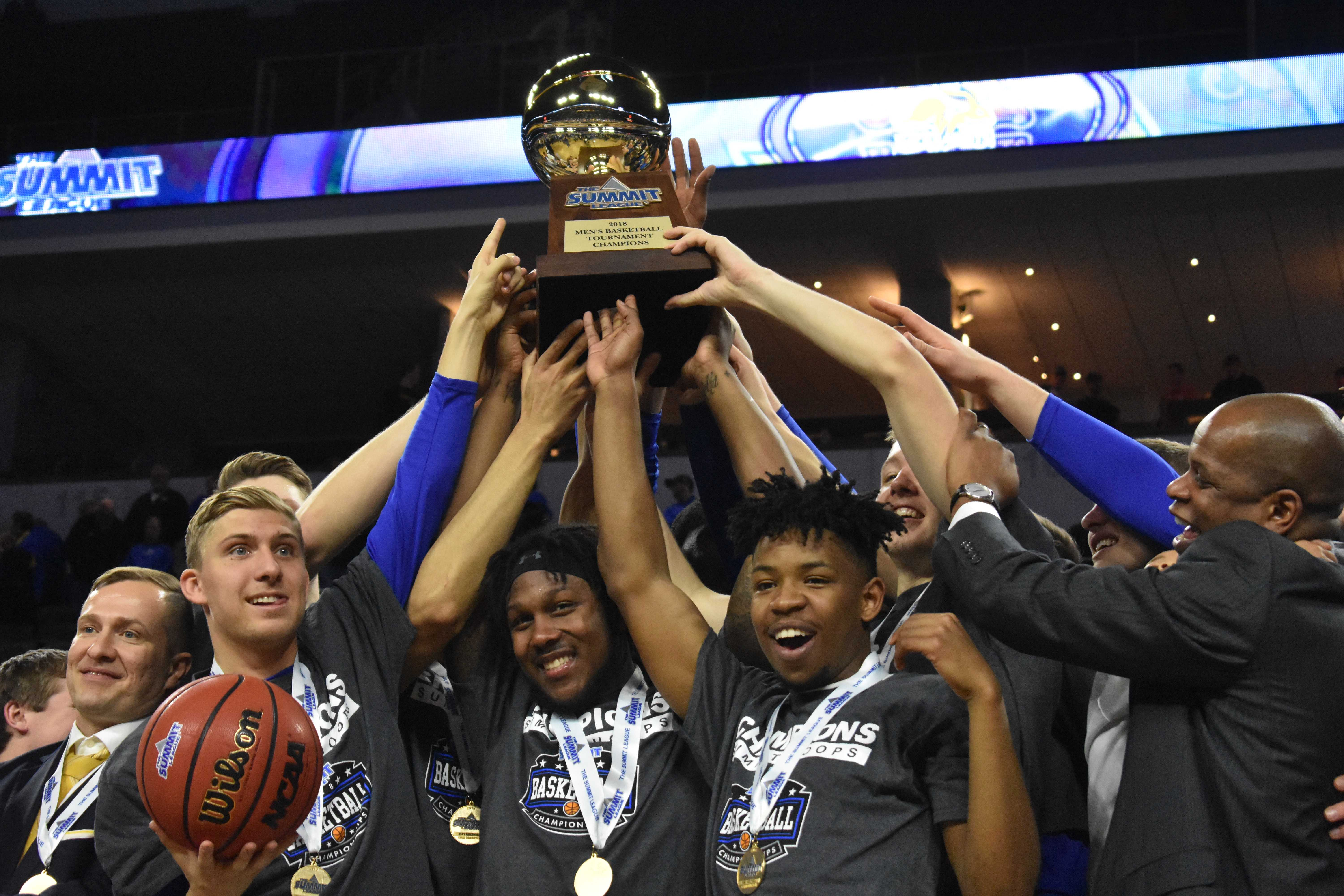 ABBY FULLENKAMP Beau Brown, David Jenkins Jr., Brandon Key and the rest of the Jacks holdup the Summit League Championship Tournament trophy after the win against USD March 6. The Jacks beat the Coyotes 97-87. SDSU is a No. 12 seed in the NCAA Tournament.