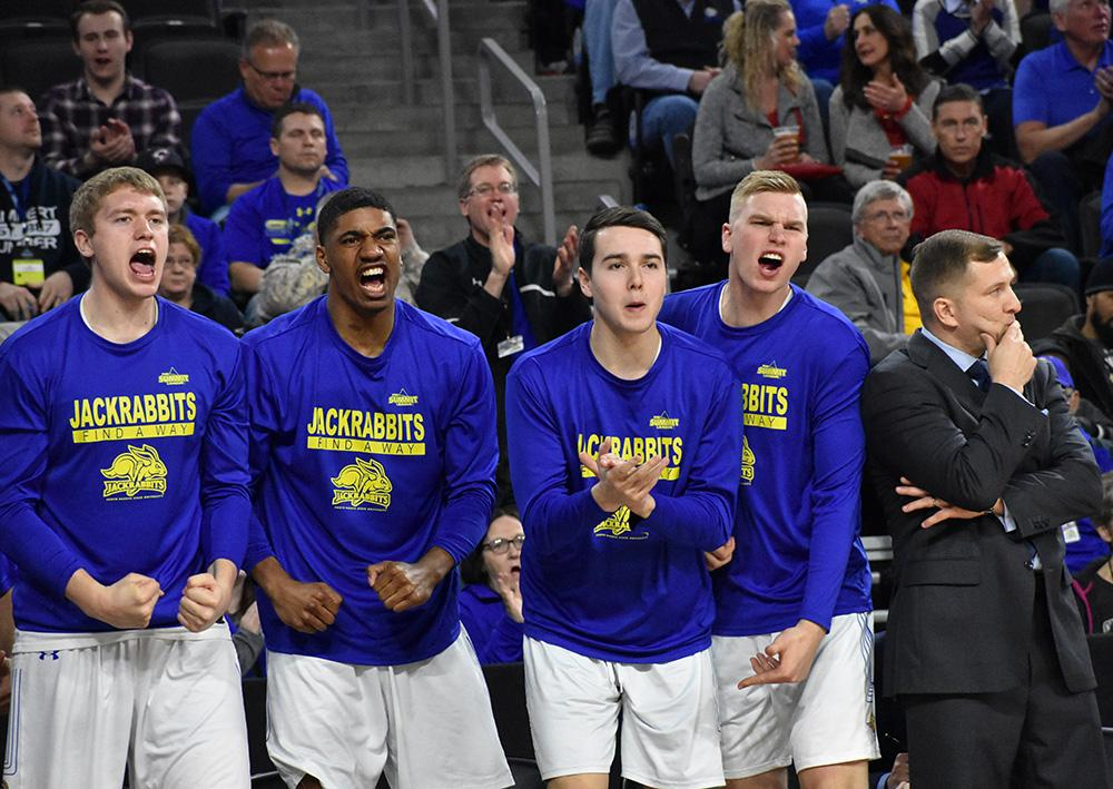 Freshmen Matt Dentlinger (32), Alou Dillion Jr. (10), Alex Arians (34) and Ryan Krueger (4) celebrate Tevin King's (2) basket during the second half of the game against WIU March 3. SDSU won 66-60. The Jacks will play March 5 in the semifinals. By: Abby Fullenkamp