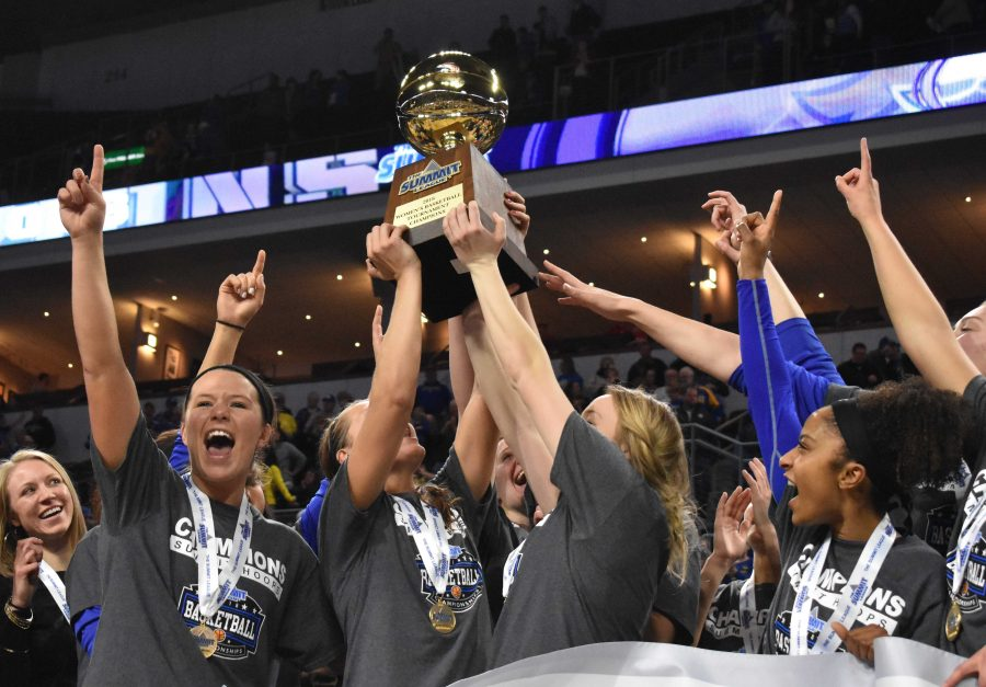 The+Jacks+hoist+the+Summit+League+Championship+trophy+March+6+at+the+Denny+Sanford+Premier+Center.+SDSU+beat+USD+65-50.+By%3A+Abby+Fullenkamp
