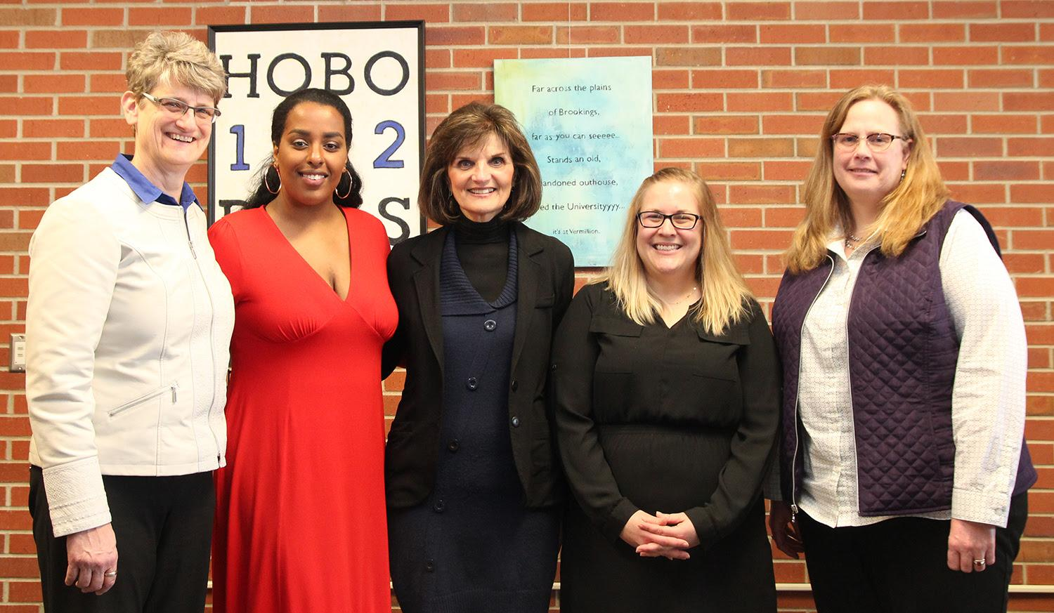 From left are the 2018 April Brooks Woman of Distinction Award recipients: Jane Mort, Semehar Ghebrekidan, Janet Johnson, Lacey McCormack and Michelle Leeds.