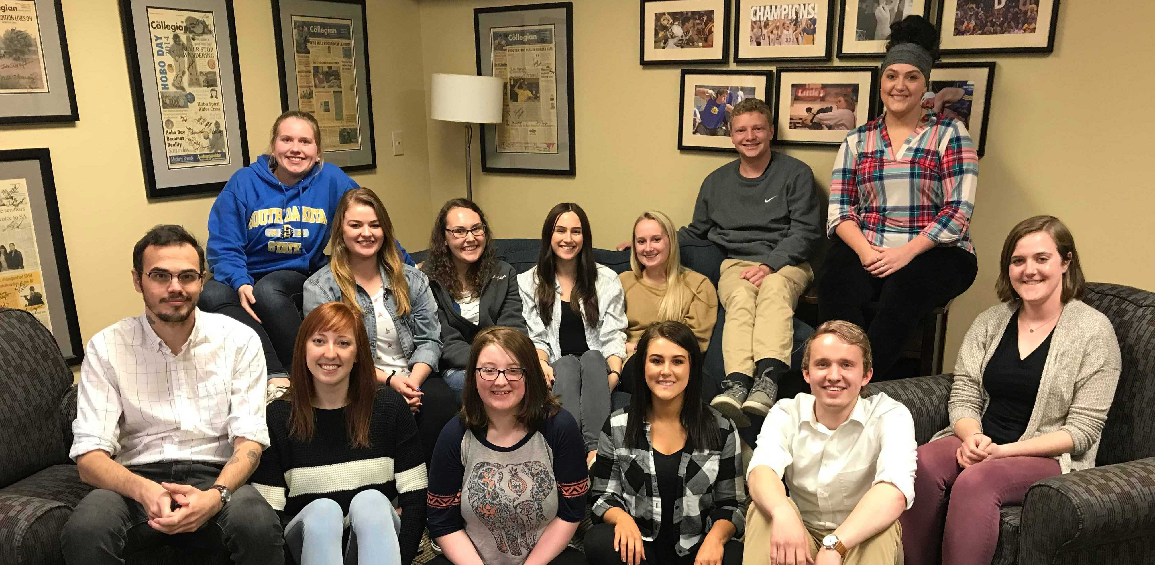 MAKENZIE HUBER The spring 2018 Collegian editorial staff shows its support for the national movement #SaveStudentNewsrooms. On April 25, more than 100 newsrooms across the country are shedding light on issues student media faces on college campuses.