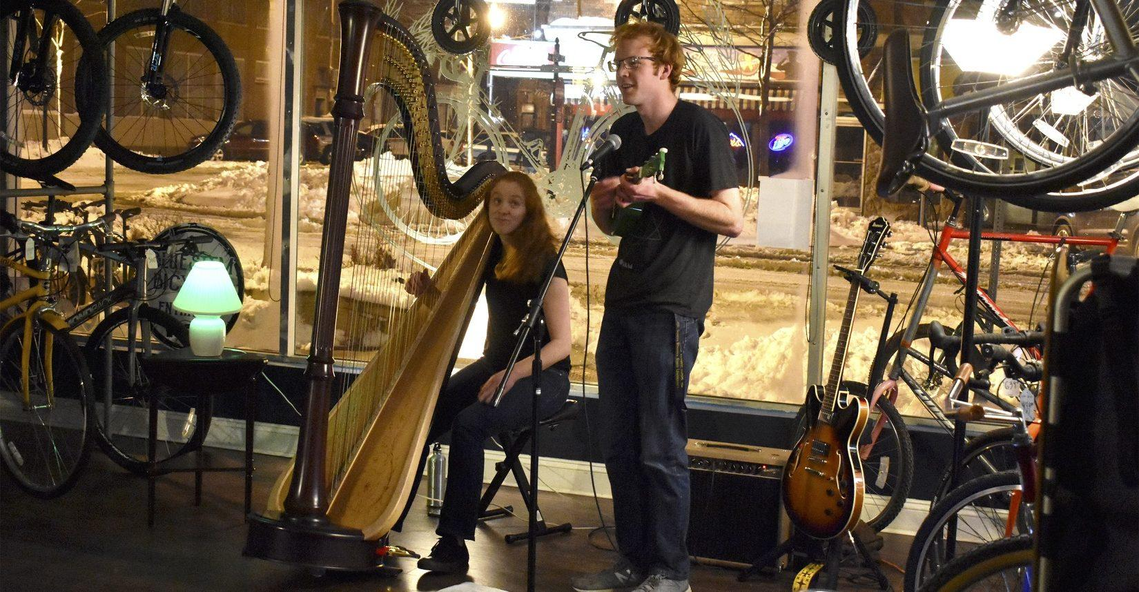 ABBY FULLENKAMP Tuthill Balloon Club's Mark and Ann McLaughlin perform one of Mark's original songs at their March 24 performance in the Blustem bike shop, downtown Brookings. The brother-sister duo started performing different shows together a few years ago.