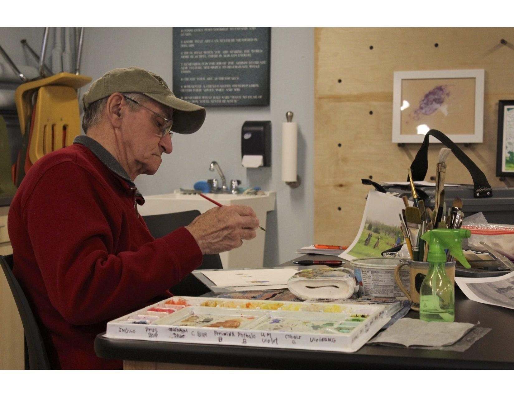 MIRANDA SAMPSON Roger Bommersbach paints a watercolor picture during the painting class March 5 in the basement of the Brookings Arts Council building. The