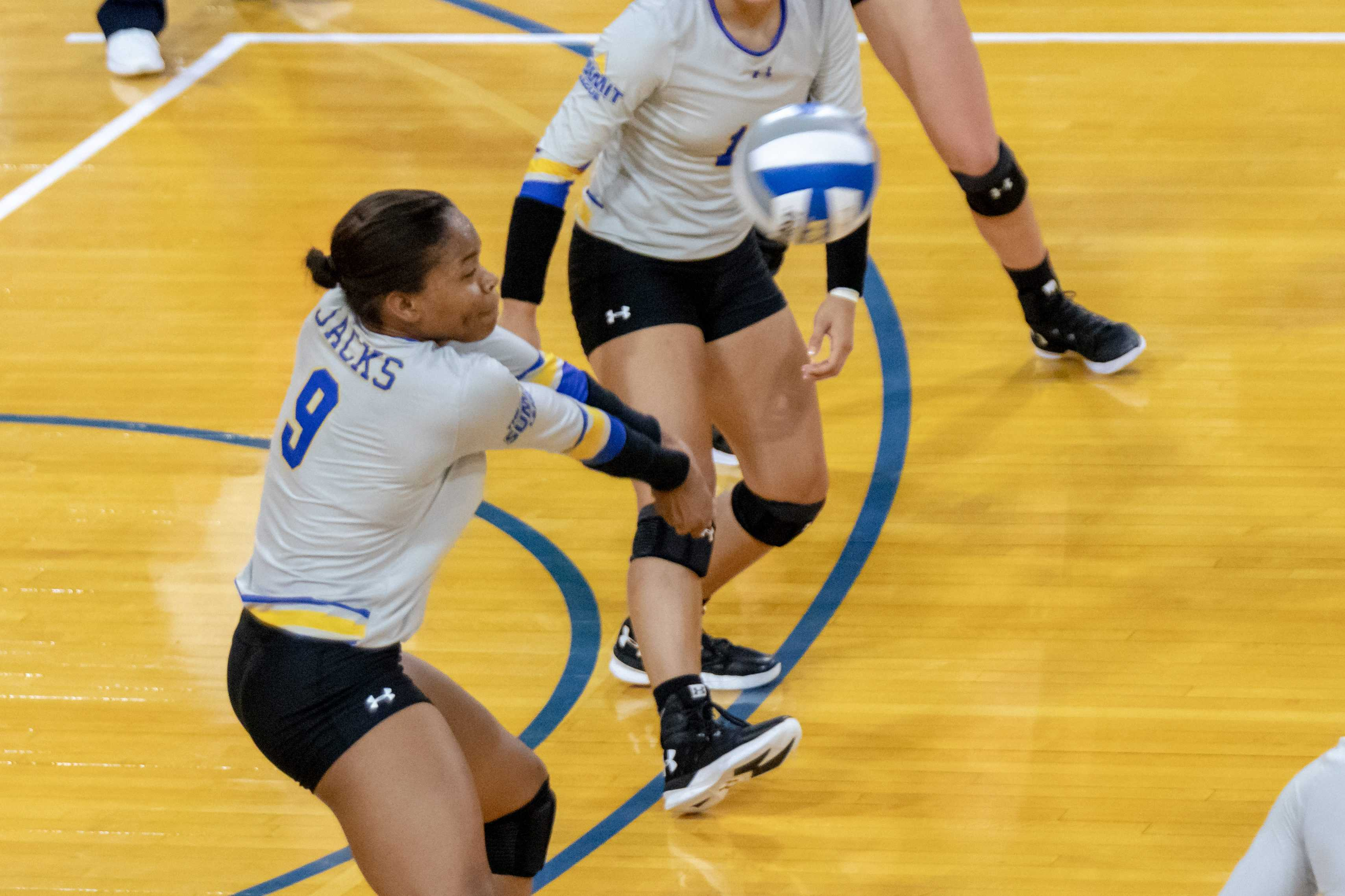 MIRANDA SAMPSON Freshman outside hitter Crystal Burke (9) passes the ball during the Comfort Suites University Jackrabbit Invitational against Green Bay on Saturday, Sept. 1 at Frost Arena.