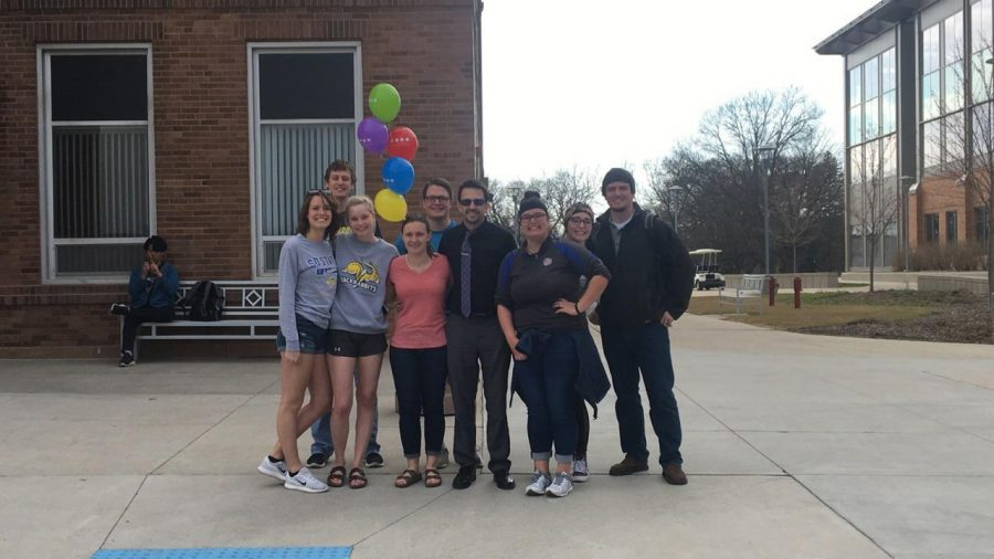 SUBMITTED+Ronnie+Straub+and+some+of+his+student-employees+gather+while+admiring+the+vibrant+colors+outside+Morrill+Hall+the+day+he+received+his+glasses.