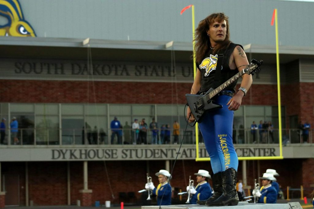 MIRANDA+SAMPSON%0ASenior+music+education+major+Duel+Shape+performs+with+the+Pride+of+the+Dakotas+with+their+halftime+show+%22Guitar+Hero%22+at+the+South+Dakota+State+vs.+Montana+State+game.+